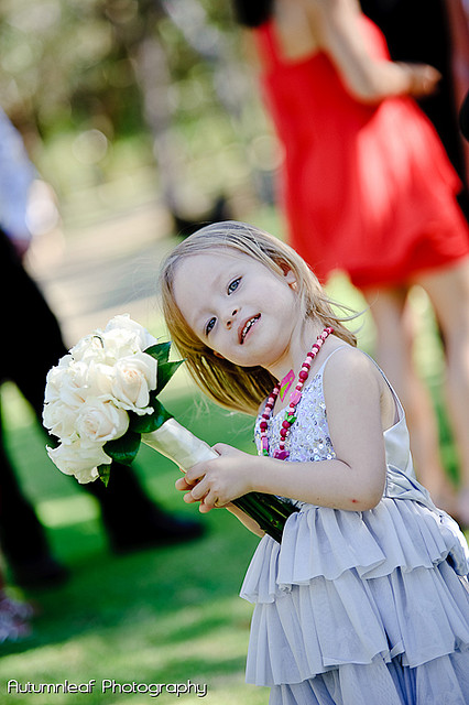 Ari & Shaun's Wedding - Cute girl holding a bouquet